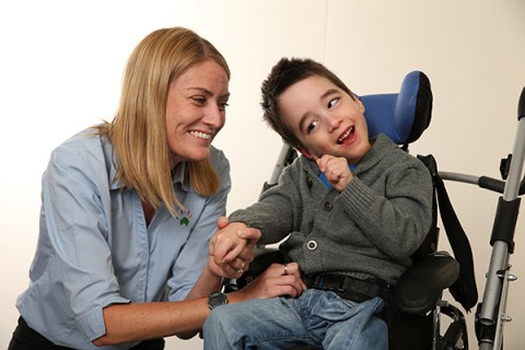 carer looking after cerebral palsy patient